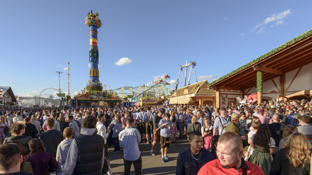 STUTTGART, GERMANY - OCTOBER 02: view of crowd of visitors among stalls in the carnival. Shot at Oktoberfest in city center on oct 02, 2016 Stuttgart, Germany