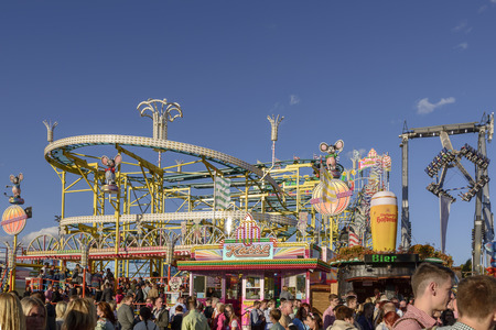 STUTTGART, GERMANY - OCTOBER 02: view of rollercoaster and revolving tower in carnival. Shot at Oktoberfest in city center on oct 02, 2016 Stuttgart, Germany Editorial