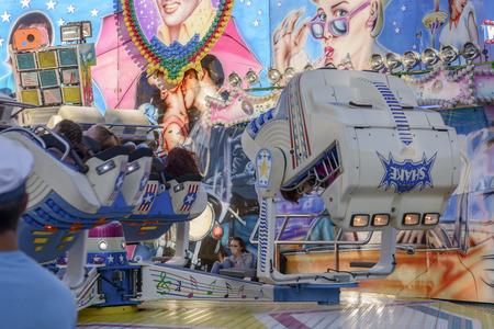 wheeling: STUTTGART, GERMANY - OCTOBER 02: foreshortening of wheeling whirligig in carnival visitors That rolls upside down. Shot at Oktoberfest in city center on oct 02, 2016 Stuttgart, Germany