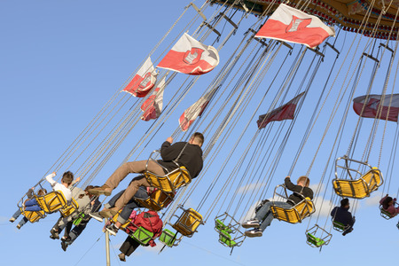 wheeling: STUTTGART, GERMANY - OCTOBER 02: view of visitors and flags on fast in carnival carousel. Shot at Oktoberfest in city center on oct 02, 2016 Stuttgart, Germany