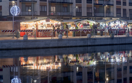 MILAN, ITALY - DECEMBER 22: Christmas market stalls at marina embankment on a quiet weekday evening shot on dec 22 2016 Milan, Lombardy, Italy