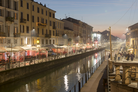 MILAN, ITALY - DECEMBER 12: Naviglio Grande at dusk with Xmas lights on a quiet weekday evening shot on dec 22 2016 Milan, Lombardy, Italy Editorial