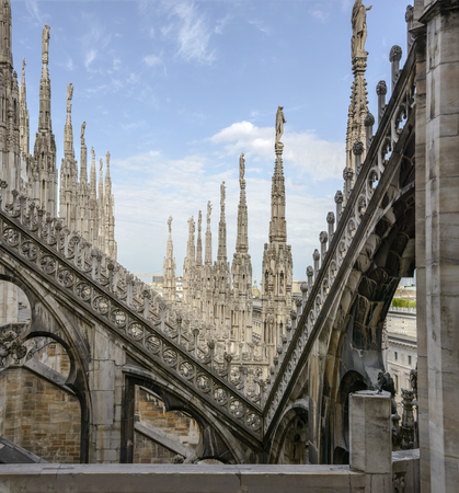 View of a line of spires at ancient cathedral, shot on a bright summer day in Milan, Lombardy, Italy