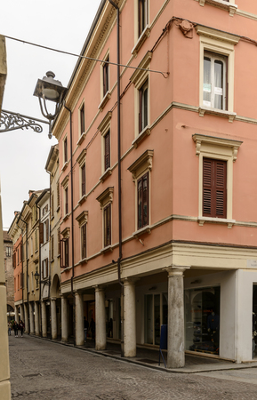 view of old houses with covered walkway on marble columns, shot at Mantua, Lombardy, Italy Editorial