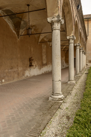 View of Romanesque arched loggia in front of San Francesco church, shot at Mantua, Lombardy, Italy