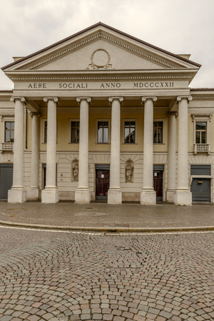 View of Neoclassical facade of Old Social Theater in city center, shot in bright cloudy light at Mantua, Lombardy, Italy Stock Photo
