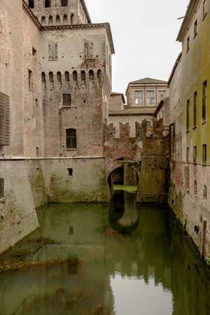 Detail of bridge on the moat of castle at Gonzaga Ducale Palace, shot in bright cloudy light at Mantua, Lombardy, Italy Stock Photo