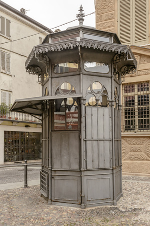 view of old iron kiosk in city center, shot in bright cloudy light at Mantua, Lombardy, Italy