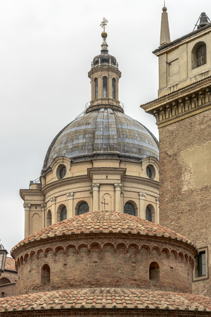 foreshortening of the domes of San Lorenzo and St. Andrea churches, shot in bright cloudy light at Mantua, Lombardy, Italy