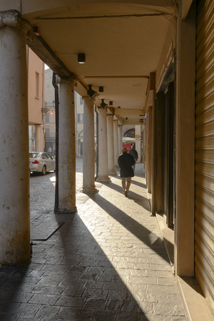 sunlight under covered walkway on marble columns, shot at Mantua, Lombardy, Italy
