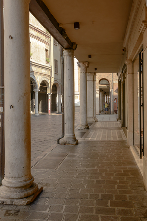 foreshortening of covered walkways under renaissance buildings in city center, shot at Mantua, Lombardy, Italy Editorial