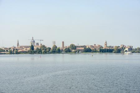 skyline of historic town on Mincio lake, shot in bright autumn sunlight at Mantua, Lombardy, Italy