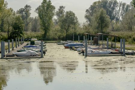 little leisure harbor in Mincio lake Park around Town, shot in bright fall light at Mantua, Italy