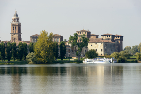 view of Ducale Palace from the water of Mincio lake, shot in bright autumn sunlight at Mantua, Lombardy, Italy