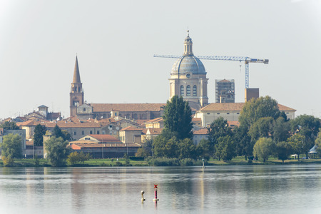 view of St. Andrea church from the water of Mincio lake, shot in bright autumn sunlight at Mantua, Lombardy, Italy