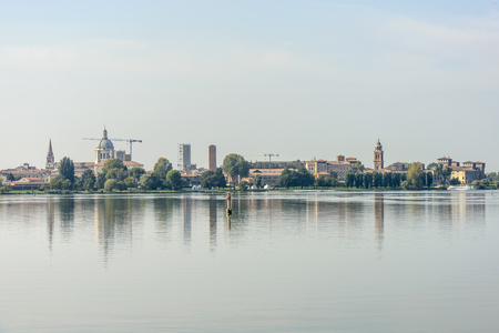 skyline from the water of historic town on Mincio lake, shot in bright autumn sunlight at Mantua, Lombardy, Italy Stock Photo