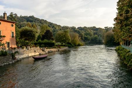 view of Mincio river, shot in bright fall light at Valeggio, Verona, Veneto, Italy Stock Photo