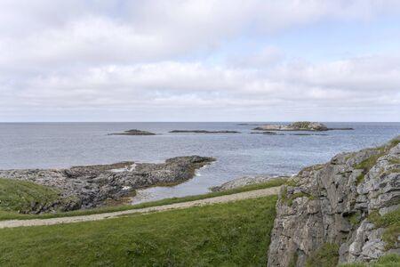 landscape with island and cliffs, shot at under bright summer light near Bleik, Andoya, Vesteralen, Norway