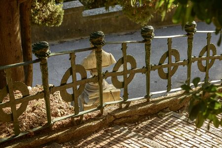 decorated wrought iron railing at historical monumental Staglieno Cemetery in town, shot in bright winter light in Genoa, Liguria, Italy
