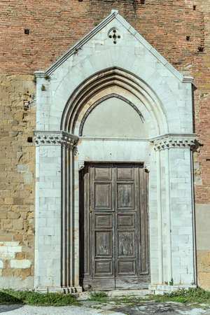 cityscape with marble portal of san Francesco church at hilltop historical little town, shot in bright light at Montepulciano, Siena, Tuscany, Italy
