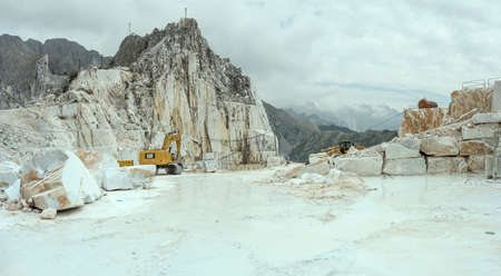 CARRARA, ITALY - september 19 2020: marble quarry with machinery standing still at Sunday rest time, shot in bright cloudy light on september 19 2020 near Carrara, Apuane, Tuscany, Italy Editorial
