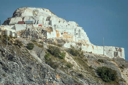 CARRARA, ITALY - september 19 2020: wall painting on cliff at marble quarry on mountain top, shot in bright light on september 19 2020 near Carrara, Apuane, Tuscany, Italy