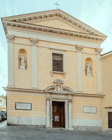 cityscape with classical facade of Madonna del Carmine church, shot at Carrara, Tuscany, Italy