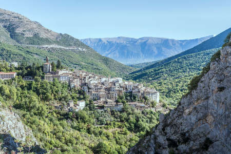 aerial landscape with historical village on Sagittario river gorge steep rocky slopes, shot in bright light at Anversa, L'Aquila, Abruzzo, Italy