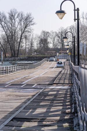 wooden lane at pontoon bridge on Ticino river, shot on bright winter day at Bereguardo, Pavia, Lombardy, Italy