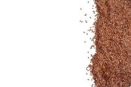 heap of brown flax seeds isolated on white background