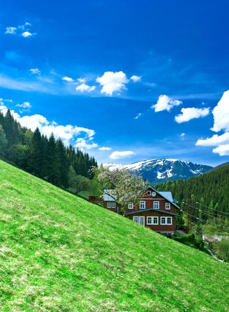 Krkonose mountains with chalet,spring view.