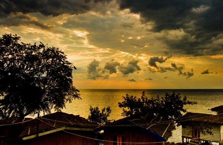 Sunrise with dramatic sky above Malawi lake