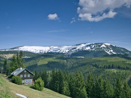 Panoramic view of krkonose mountains with chalet