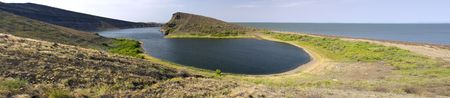 Composed panorama of Crocodile lake on Central island on Lake Turkana,northern Kenya.