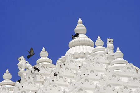 Detail of jain temple tower with clear blue sky background