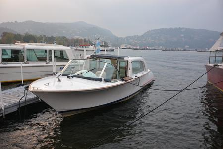 lake como: boat on Lake Como, fog