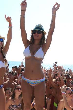 happyhour: Girl dances on the beach, happyhour beach, beach party by the sea, hands to the sky,