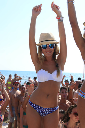 happyhour: Girl dances on the beach, happyhour beach, beach party by the sea Editorial