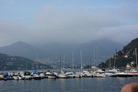lake como: View of Lake Como, fog and boats