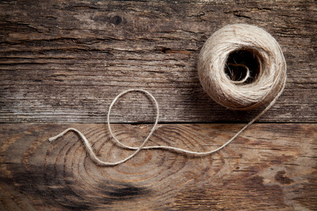 Rope coil on old wooden background,  Top view  photo