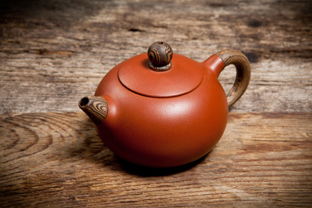 fireclay: Teapot on old wooden table