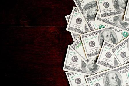 Background with money american hundred dollar bills on wooden desk Standard-Bild