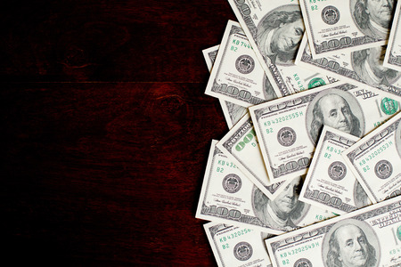 Background with money american hundred dollar bills on wooden desk Archivio Fotografico