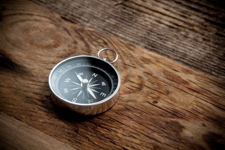 Compass on a wooden background Stock Photo - 29449626