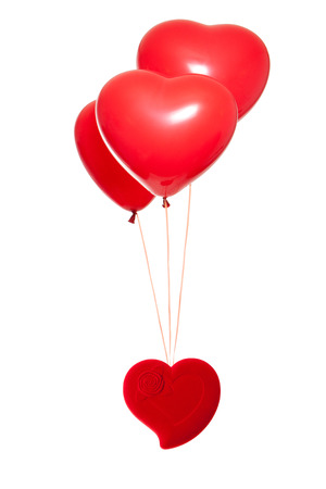 Fancy box with a red heart-shaped balloon, isolated against white background Standard-Bild