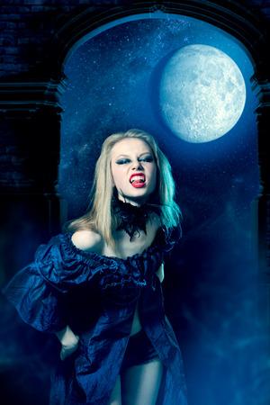Aggressive vampire girl looking at camera