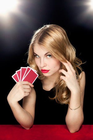cards poker: young girl playing in the gambling in casino Stock Photo