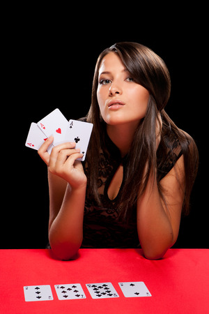 young woman playing in the gambling in casino photo