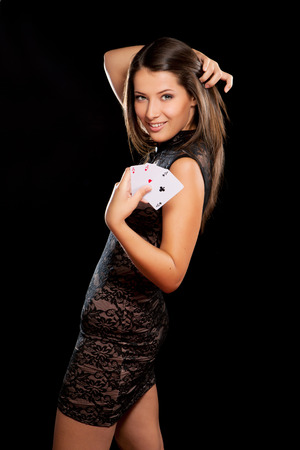 young woman playing in the gambling on black background