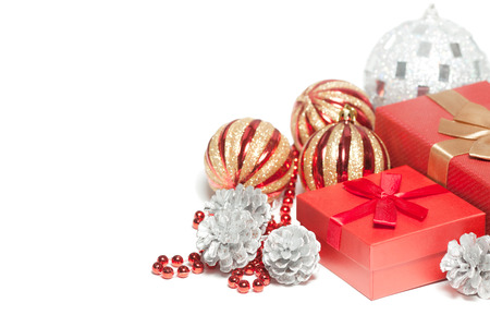 Red Christmas gift box and balls isolated on white background. photo